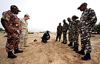 US Navy 110426-F-XM360-035 Chief Explosive Ordnance Technician Justin Berlien, second left, observes Namibia Defense Forces (NDF) EOD and Namibian.jpg