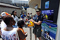 US Navy 110528-N-GO025-009 Chief Warrant Officer Tim Andros alks to spectators during a Navy diver demonstration at the New York Aquarium during Fl.jpg