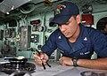 US Navy 110813-N-PV215-059 Quartermaster 3rd Class Scott McCutcheon plots the ship's position in the pilothouse of the amphibious transport dock sh.jpg