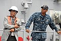 US Navy 110815-N-SP676-138 Lt. Cmdr. Todd S. Levant observes sea and anchor detail aboard the mine countermeasures ship USS Defender (MCM 2) with t.jpg