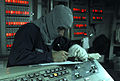 US Navy 110905-N-GH121-011 Hull Technician Fireman Jeremy Ramberg signs the log sheet as central watch in Damage Control Central during a general q.jpg