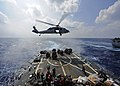 US Navy 111025-N-VH839-048 An MH-60R Sea Hawk helicopter transfers supplies to the flight deck of the Arleigh Burke-class guided-missile destroyer.jpg