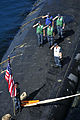 US Navy 111110-N-JH293-141 Sailors aboard the Virginia-class submarine USS Texas (SSN 775) salute the national ensign during the shifting of color.jpg