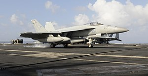 US Navy 111222-N-RG587-016 An F-A-18E Super Hornet assigned to Strike Fighter Squadron (VFA) 81 makes an arrested landing on the flight deck aboard.jpg
