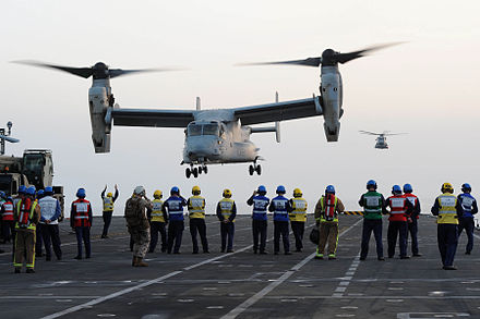 A USMC V-22 Osprey landing on the deck of HMS Illustrious