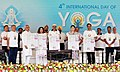 V.P. Singh Badnore and the Union Minister for Textiles, Smt. Smriti Irani releasing a calendar of Yoga classes, on the occasion of the 4th International Day of Yoga 2018, in Chandigarh.JPG