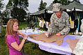 Veteran's Administration Hospital grounds in Fargo, N.D. Erickson is being assisted by Staff Sgt. Heather Prigge, also of DVIDS304735.jpg