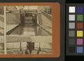 View of locks, showing a boat locking through, Lockport, N.Y (NYPL b11707980-1696411).tiff