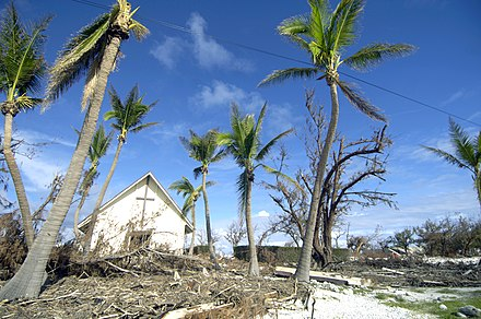 Damaged trees and debris left by Super Typhoon Ioke in 2006 at the Memorial Chapel on Wake Island Wake Island Memorial Chapel damaged by Hurricane-Typhoon Ioke 2006.jpg