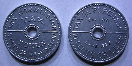 "An aluminum sales tax token from the state of Washington, valued at 2 mills ( /5 cent) and good for the ""tax on purchase of 10 cents or less"" under the state's 2% retail sales tax law. Washington Tax Tokens From 1935.jpg"