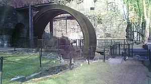 An Overshot Mill in Aberdulais, Wales - The Waterwheel used for electric power at Aberdulais in 2007 (spokes blurred out)