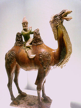 Xinjiang - A Sogdian man on a Bactrian camel, sancai ceramic statuette, Tang dynasty