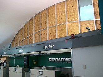 St. Louis Lambert International Airport - Terminal 1 windows boarded up after the tornado