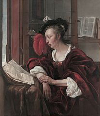 A well-dressed Lady reading