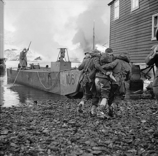 File:Wounded being helped onto a landing craft.jpg