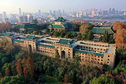 The old library (center), dorm (below), and schools of literature and law (left and right) of Wuhan University Wuhan University Sakura Castle.jpg