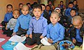 Young Afghan boys sit for classes on the hallway floor of the Aliabad School near Mazar-e-Sharif, Afghanistan, March 10, 2012 120310-A-LE308-002.jpg