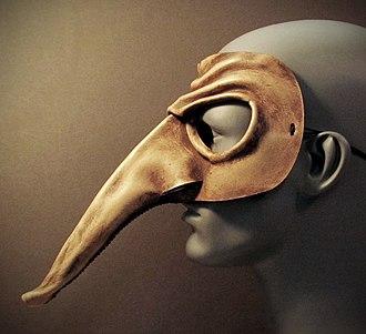 Zanni - A leather version of a Zanni mask, profile view