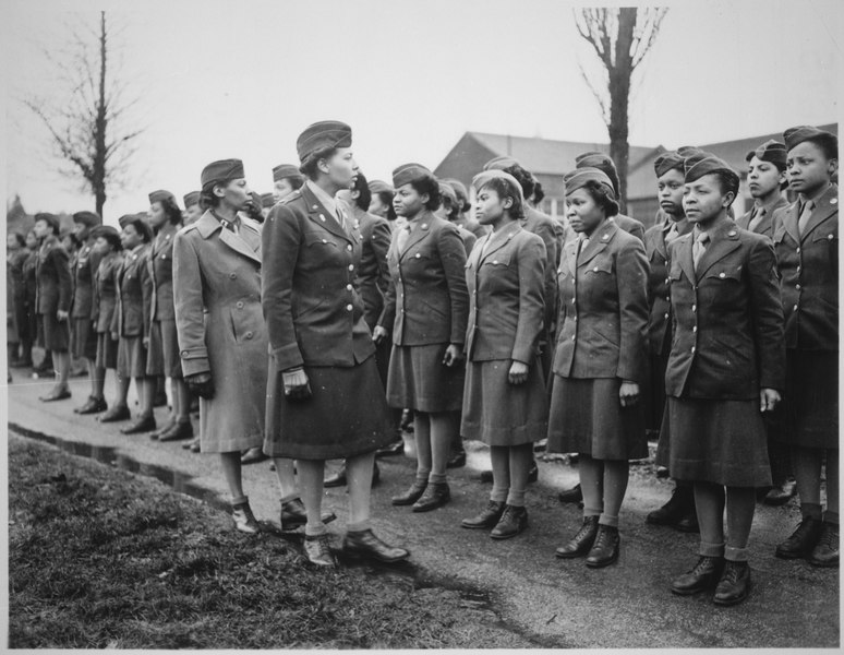 """Somewhere in England, Maj. Charity E. Adams...and Capt. Abbie N. Campbell...inspect the first contingent of Negro mem - NARA - 531249"