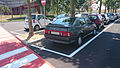 """ 15 - ITALY - Parked automobiles out of Museo Storico Alfa Romeo Milan - in this pics Alfa Romeo 75 gray sedan facing right.jpg"