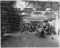 (Torpedo storage building with sailors working on torpedoes at the Submarine Base, Los Angeles.) - NARA - 295470.tif