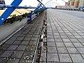 Černý Most, chodník na estakádě metra, rozbořený kanálek.jpg