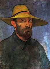 Self-portrait in a straw hat.