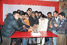group cutting a cake
