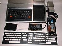 1979 TI-99-4 with Speech Synthesizer, RF modulator, keyboard overlays.jpg