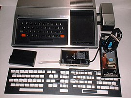 1979 TI-99-4 with Speech Synthesizer, RF modulator, keyboard overlays.jpg