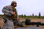 19th Group soldier instructs Serbian soldier on 240B