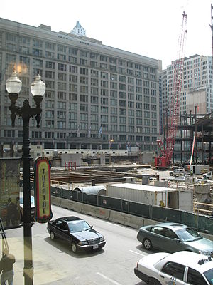 "Marshall Field and Company Building - Marshall Field and Company Buildings front facade on North State Street, pictured behind adjacent ""Block 37"" construction project underway across State Street."