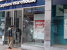 A window of this mobile phone store has been badly damaged by violence. Image: Clare Lovell.