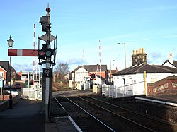 2018 at Gobowen station - signal GN4 and level crossing.JPG