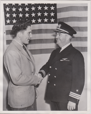 Fred Hutchinson -  Hutchinson, age 22, is congratulated upon his 1941 enlistment in the U.S. Navy.
