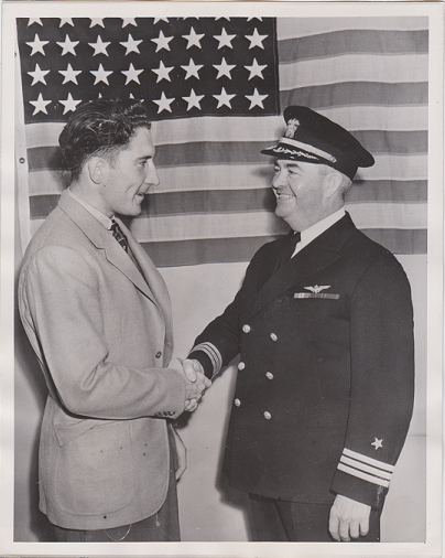 22 year old Fred Hutchinson is congratulated at recruiting station upon his 1941 enlistment in the U.S. Navy