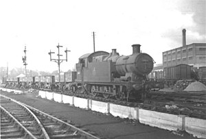 Slough - Former GWR locomotive 6664 photographed near the engine shed at Slough, October 1955.