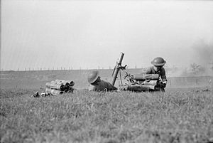 Operation Plunder - 3-inch mortar of the 8th Battalion, Royal Scots, part of the 15th (Scottish) Division, under enemy fire during the Rhine crossing, 24 March 1945.