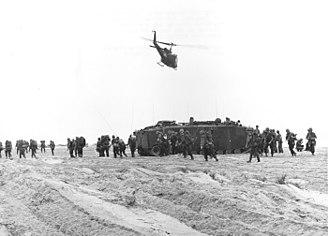 Operation Double Eagle - Company F, 2/4 Marines pass an LVT-5