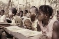 ASC Leiden - Coutinho Collection - F 26 - Farim, Northern frontline, Guinea-Bissau - Woman with child at school - 1974.tif