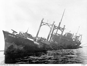 Invasion of Buna–Gona - Wreck of the Ayotosan Maru, a transport which was sunk during the initial landing shortly after disembarkation. AWM014871
