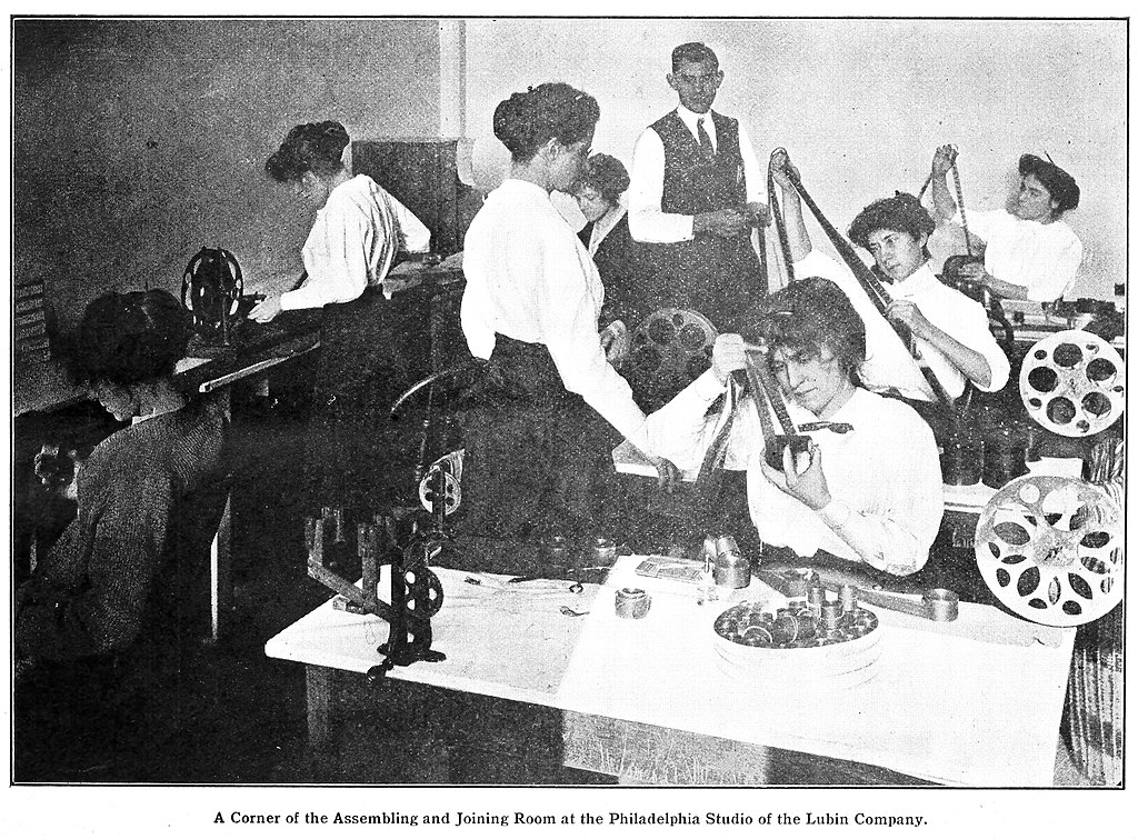 Editing film at the Lubin film studio in Philadelphia, 1914. A reel hard job.