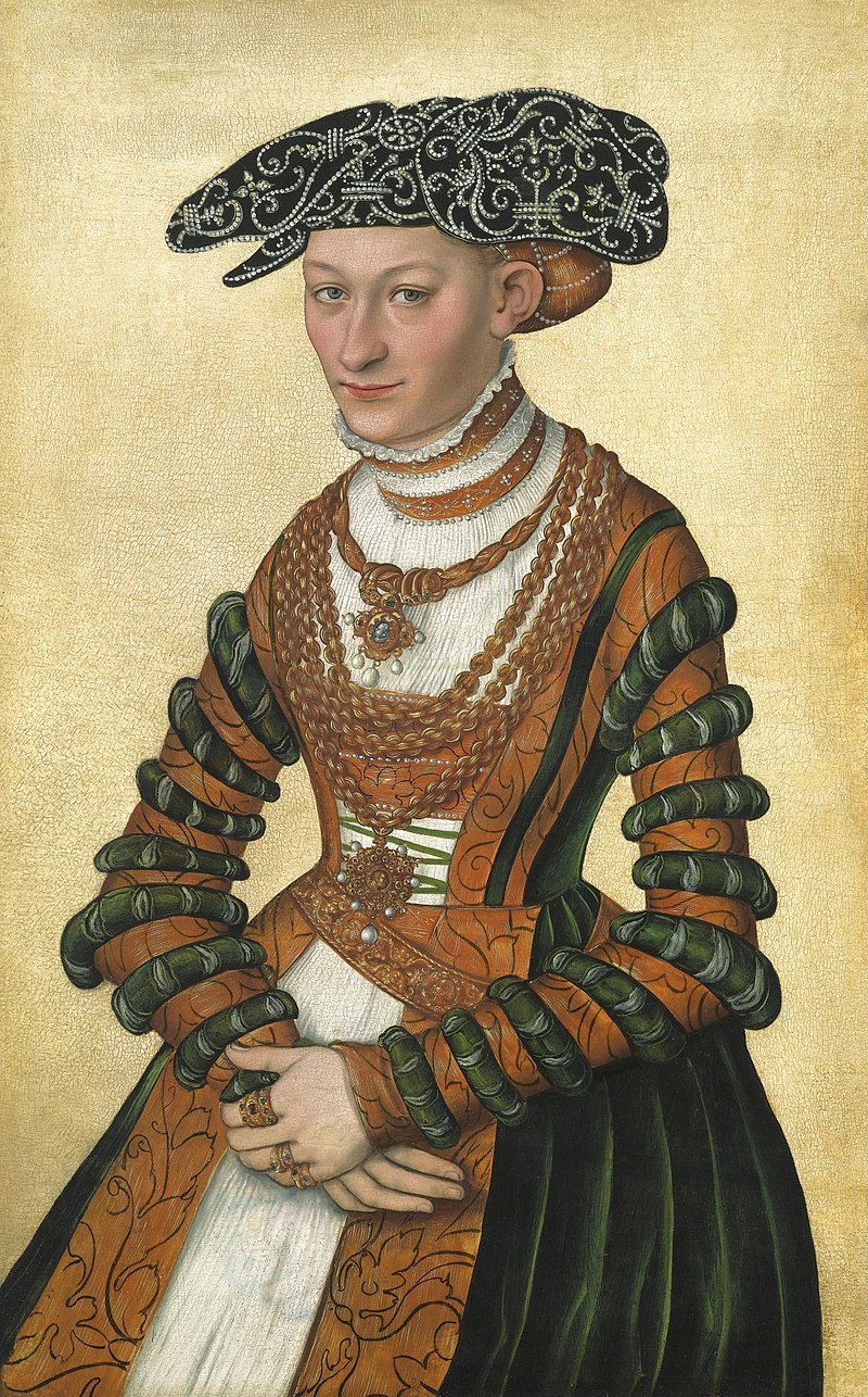 A Lady in a green velvet and orange dress and a pearl-embroidered black hat by Lucas Cranach II.jpg