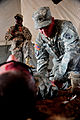 A U.S. Army medic, right, with the 10th Army Air and Missile Defense Command treats a Soldier with simulated wounds during a medical exercise for Austere Challenge 2012 in Beit Ezra, Israel 121022-F-QW942-051.jpg