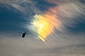 A U.S. Coast Guard HH-65C Dolphin rescue helicopter assigned to Coast Guard Air Station Atlantic City flies near a circumhorizontal arc, an atmospheric phenomenon sometimes called a fire rainbow, Nov. 6, 2013 131106-Z-NI803-308.jpg