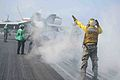 A U.S. Sailor directs an aircraft on to a catapult aboard the aircraft carrier USS John C. Stennis (CVN 74) in the Pacific Ocean April 20, 2013 130420-N-TC437-077.jpg