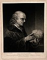 A bald phrenologist with a large forehead examining a skull, Wellcome V0009464.jpg