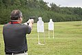 A business leader attending a Marine Corps Executive Forum (MCEF) fires an M9 Beretta pistol at a target aboard Marine Corps Base Quantico, Va., July 11, 2013 130711-M-MI461-351.jpg