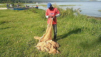 Fishing in Uganda - A fisherman with a fish net for sprat