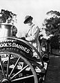 A milkwoman standing on her dairy cart in southern England during the First Wotrld War. Q31137.jpg